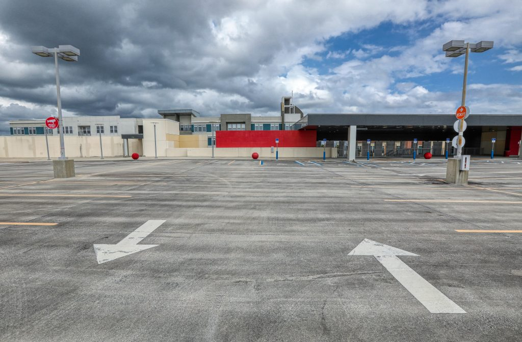 empty parking lot with clouds overhead